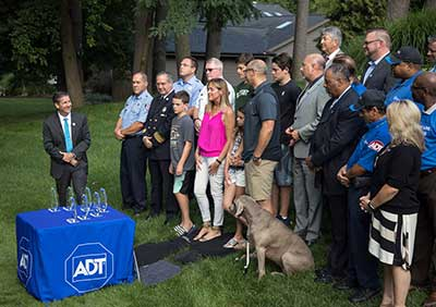 ADT CEO Tim Whall presented LifeSavers to seven ADT employees.