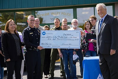 ADT presented the sheriff's office, fire department and Spokane chapter of the National Alliance on Mental Illness with $5,000.