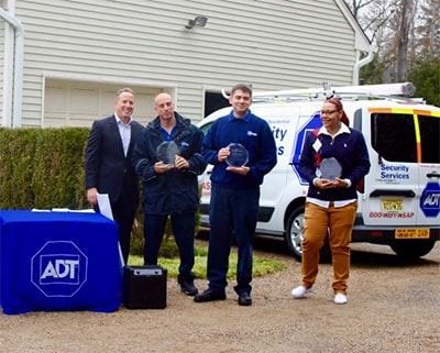 Alan Ferber, President of ADT Residential with ADT Lifesaver Award winners (from left): Service Technician Mike Glove, Installation Technician William Bondarenko and Dispatcher Krista Brandenburg.