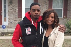 ADT Customer Tabitha Taylor and her son, Jerrel Wilson, outside their St. Louis home which was the scene of a fire.