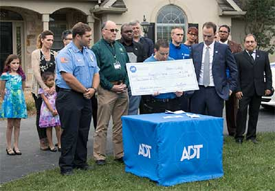 Jon Marvin, ADT VP of Customer Care presented a check for $5,000 to Penryn Fire Company.