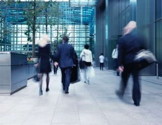 Office workers entering a building