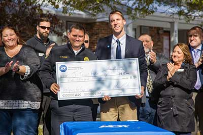 An check in the amount of $5,000 was presented to the local fire department, in thanks for their continued service to their community.