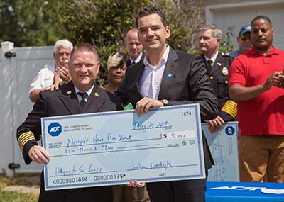 Presenting a $5,000 check to the Newport News and Chesapeake Fire Departments.