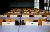 Perspective view of school tables and empty chairs